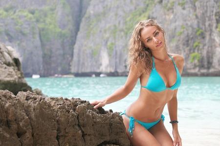 sexy model: Beautiful woman in bikini posing in thai beach with rocks