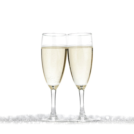 champagne flutes: Pair of champagne flutes on shiny glitter background