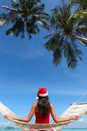 hummock: Christmas vacation - woman in santa hat on the beach in hummock