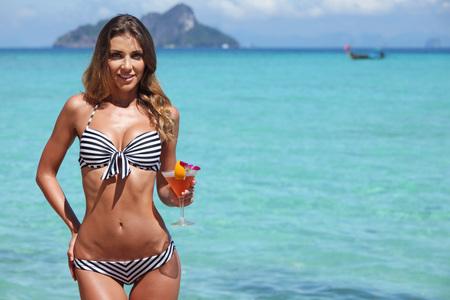 thailand beach: Sexy woman in bikini with cocktail on beach in Thailand
