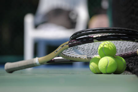 rackets: Tennis ball and racket on court close up