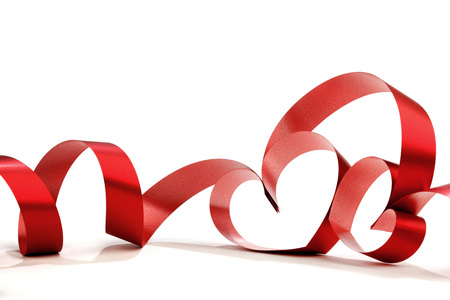 decorative design: Heart shaped red ribbon isolated on white background Stock Photo