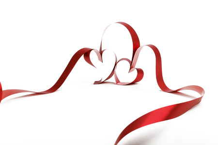 heart background: Heart shaped red ribbon isolated on white background Stock Photo