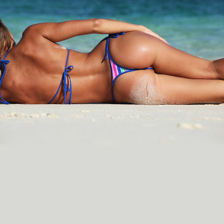 the topical: Sexy woman in bikni lying on topical beach Stock Photo