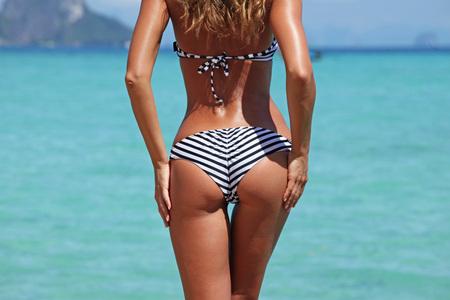 Beautiful woman with tan body on thai beach