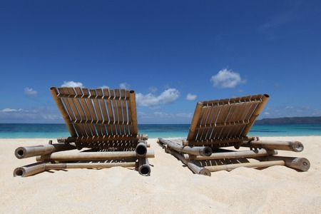 relaxing beach: Relaxing couch chairs on white sandy beach at Philippines