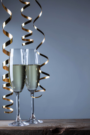 champagne glasses: Two champagne glasses and curly ribbon party concept Stock Photo