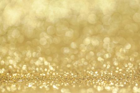 golden light: Abstract golden glitter light bokeh holiday party background Stock Photo