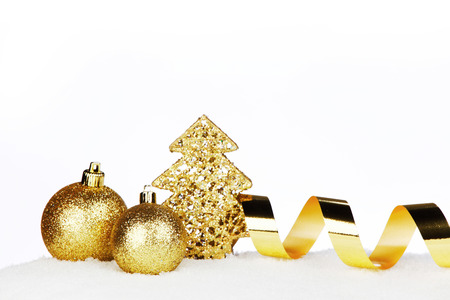 christmas gold: Golden Christmas decorations on snow close-up Stock Photo