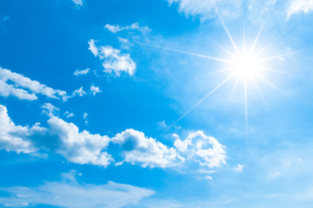 blue ray: Blue sky with white clouds and shiny sun Stock Photo