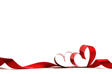 Heart shaped red ribbon isolated on white background 스톡 콘텐츠