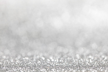 Abstract silver glitter light bokeh holiday party background