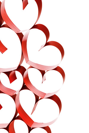 Linked red ribbon hearts isolated on white background Stock Photo