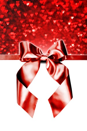 white ribbon: Red gift ribbon bow and heart bokeh isolated on white background
