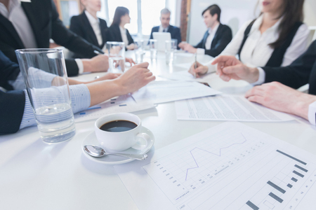 financial reports: Group of business people in meeting room at office discuss financial reports