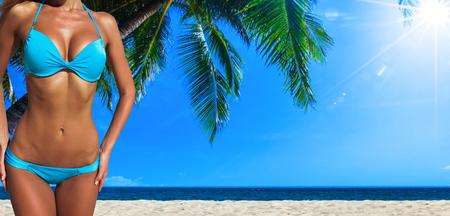 Sexy woman body on tropical sea beach background Stock Photo