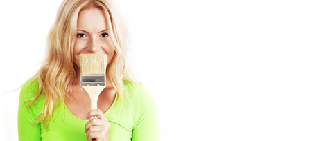 a woman with a brush against the wall photo
