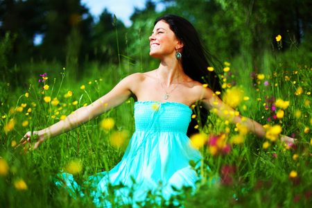 woman on summer flower field feel freedom photo