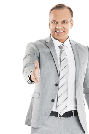 Business man stretching out hand for shaking and smiling, isolated on white background Stock Photo