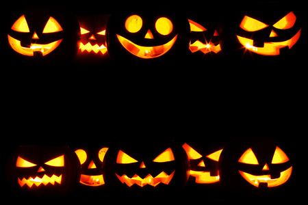 Many Halloween Pumpkin glowing faces in a row isolated on black background