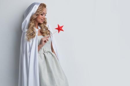 Portrait of beautiful fairy woman with star shaped magic wand Stockfoto