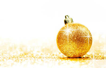 Beautiful Glitter christmas ball close-up on shining background with white copy space