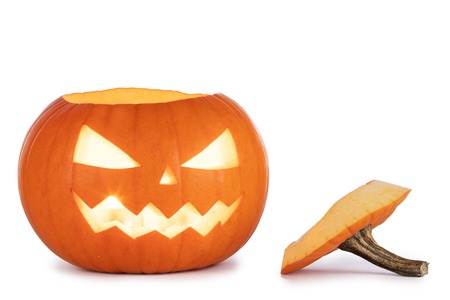 One glowing Halloween Pumpkin with peduncle away isolated on white background Imagens - 109564650