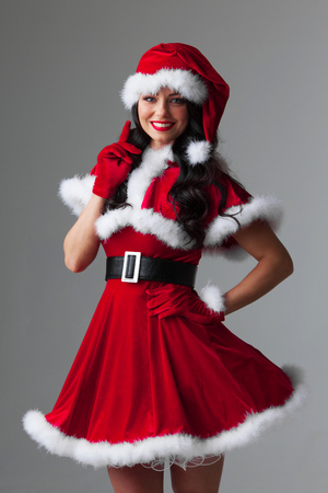 Portrait of beautiful sexy girl wearing santa claus style clothes 版權商用圖片