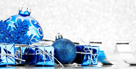 Christmas gifts and decoration on shiny glitter background Stock Photo