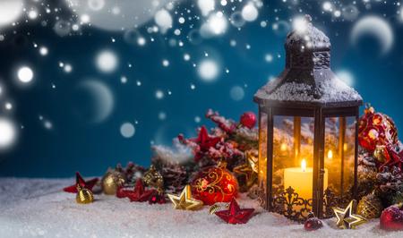 Burning candles , lantern and christmas decoration on magic bokeh lights background Archivio Fotografico