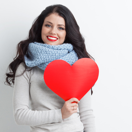 Woman holding paper heart shaped card . Valentine day concept . Im looking waiting for partner ! Advertising people person relationship couple concept , white background