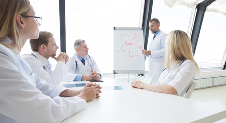 Team of doctors discuss mental health concept at presentation in clinical office