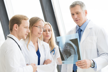 Medical colleagues discuss x-ray at clinical office Stok Fotoğraf