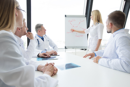 Team of doctors discuss mental health concept at presentation in clinical office Stok Fotoğraf