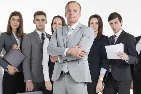 Group of business people holding documents. Business team isolated over white background