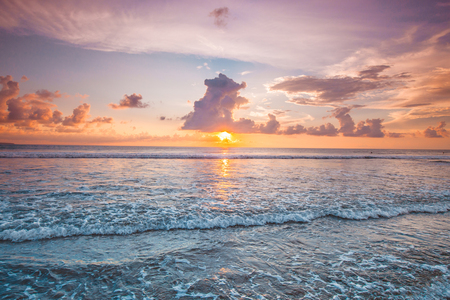 Amazing colorful sunset over sea form Bali beach