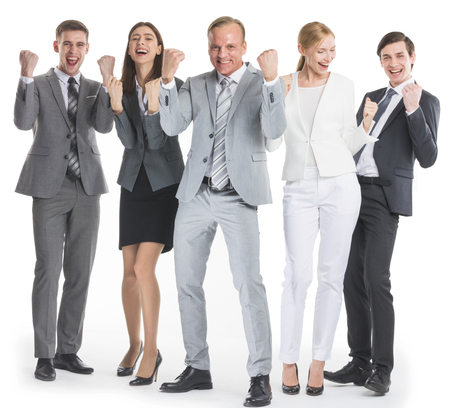 Successful excited business people group team standing together and holding fist ok yes gesture isolated over white background