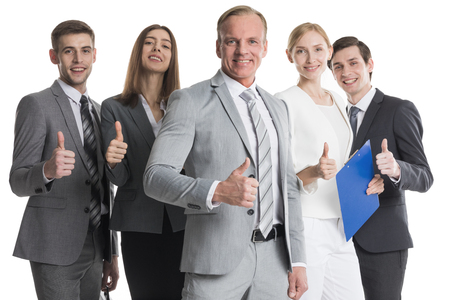 Happy business people cheering and showing thumbs up sign isolated on white background