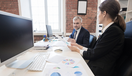 Business people working with financial documents in office