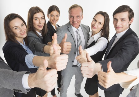 Business team showing thumb up isolated on white background Banco de Imagens