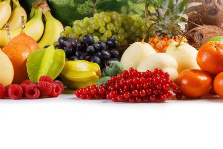Fresh tropical fruits harvest pile isolated on white background with copy space for text Zdjęcie Seryjne - 129174663
