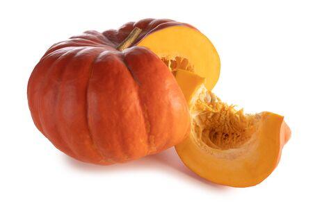 One cut orange pumpkin isolated on white background
