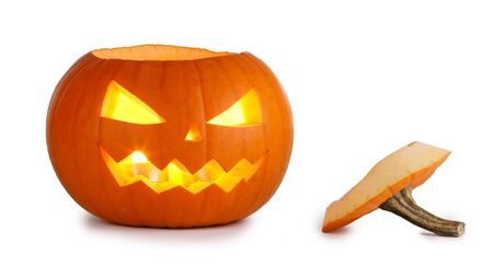 One glowing Halloween Pumpkin with peduncle away isolated on white background