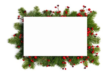 Christmas Border frame of tree branches and red berries on white background