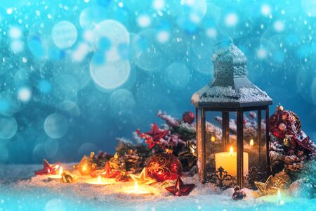 Burning candles , lantern and christmas decoration on snowfall background Stock fotó