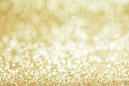 Shiny golden bokeh glitter lights abstract background, Christmas New Year party celebration concept Stockfoto