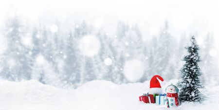 Snowman fir tree and christmas gifts on sleigh on snow, winter forest and white falling snow bokeh background Stockfoto