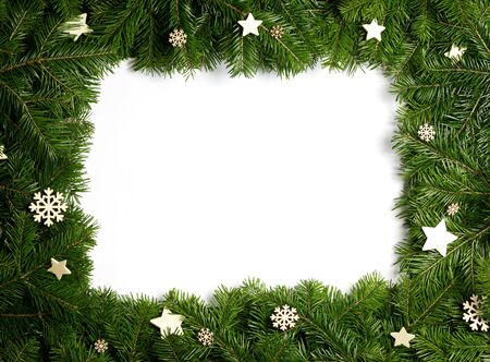 Natural fir Christmas tree border frame and wooden decor isolated on white , copy space for text Stockfoto