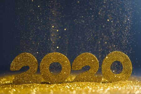 2020 New Year luxury design concept. Golden 2020 New Year horizontal template with golden glitter on blue backgound