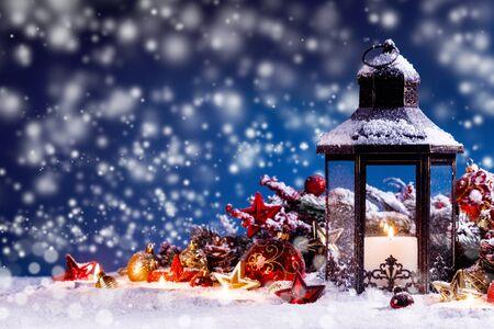 Burning candles , lantern and christmas decoration on magic bokeh lights background